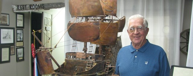 Harold Leible shows his model of the Mayflower ship constructed out of scrap metal, on display at the Basehor Historical Museum, 2812 155th St., through May.