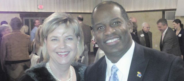 Saturday's Baldwin City Chamber of Commerce Annual Awards Dinner featured a keynote speech by Kansas football coach Turner Gill, right. After the dinner, Gill posed for pictures with several of the dinner attendees, including Cyndi Dorathy.