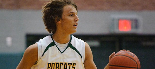 Basehor-Linwood senior Ryan O'Donnell brings the ball up the floor during the Bobcats' substate victory against Piper.