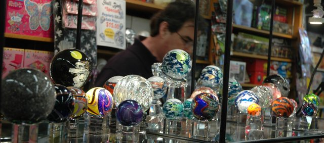 Marbles displayed during Marble Crazy included these marbles made by Geoffrey Beetem (pictured in background), Athens, Ohio. Marble Crazy will continue through Sunday.