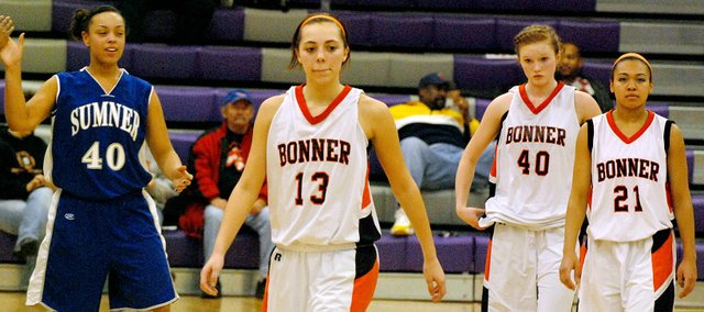 Bonner Springs senior Erica Smith (13) leaves the court for the last time after the Braves lost to Sumner Academy in the Class 4A substate semifinals. Smith played varsity basketball for four years at BSHS and was a part of 29 wins. More than half of them came during a senior campaign where she led the Braves to a 15-6 record.