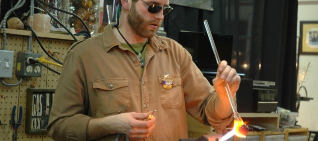Dan Neff, Duluth, Minn., demonstrates how to make a marble using a lamp-working technique. Neff was among 21 marble and glass artists who demonstrated during the 12th annual Marble Crazy on Friday and Saturday.