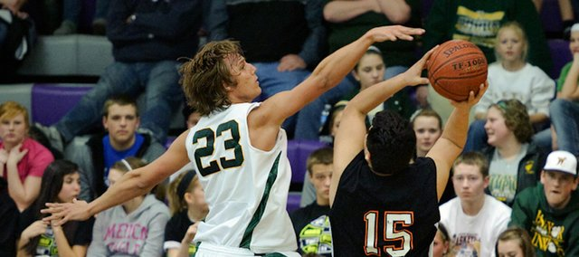 Basehor-Linwood&#39;s Ryan O&#39;Donnell attempts to block a shot by Bonner Springs&#39; Juan Pichardo during the substate semifinals.