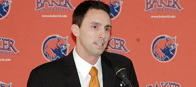 Baker University men's basketball coach Brett Ballard gives his introductory speech at his first press conference as the Wildcats' coach a year ago.