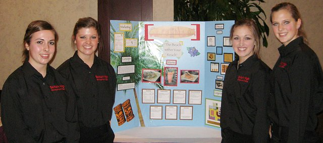 Baldwin High School's culinary management team presents its restaurant idea at the state contest in Wichita last week. The students are, from left, juniors Abi Hartzell, Paris Nottingham, Alexis Finucane and Hayley Schwartz. This year marked the third-straight state championship for Baldwin High.
