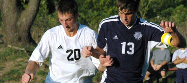 Coady Andrews, right, battles Nate Markovetz of Lansing for possession of the ball during one of Andrews' high school soccer games at Mill Valley. Andrews recently signed a professional contract with the Missouri Comets.