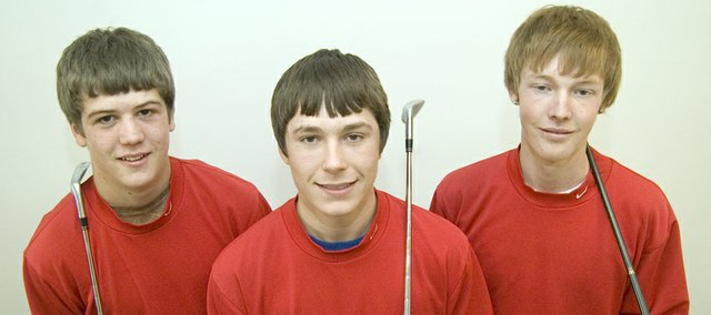Tonganoxie High golfers Tanner Hale, Colby Yates and Kody Campbell played at the Class 4A state tournament last year as sophomores. This season, as juniors, they have high expectations for the blooming program.