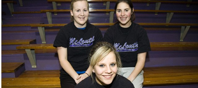 McLouth High softball seniors (front) Jessie Troupe, (back) Kaitlyn Sparks and Kaley Patterson form the core of a Bulldogs squad that came within one victory of a Class 3A state tournament berth in 2010. McLouth lost just one senior from that team, which finished 14-6, and its players are planning on returning to the state tournament  for the first time since 2008.