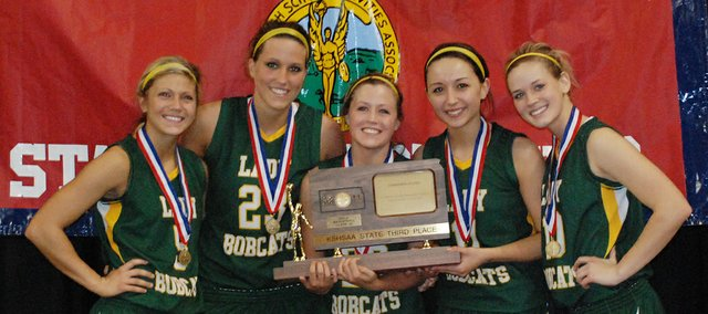 Basehor-Linwood seniors, from left, Shelby Equels, Megan Bergstrom, Amanda O&#39;Bryan, Courtney Poe and Macyn Sanders pose with the third-place trophy that the Bobcats earned at the Class 4A state tournament.