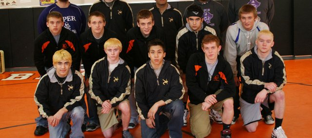 The All-Wayndotte County Wrestling Team has been announced. Members are, from left, front row: Tony Arzola (Turner), P.J. Cheney (Turner), Tyler Freeman (Turner), Caleb Seaton (Bonner), James Lohman (Turner); second row: Jonathan Blackwell (Bonner), Aaron Puckett (Bonner), Joe Mohler (Turner), Jaysson Tansey (Sumner); and, back row: coach Zach Davies (Piper), Tyler Kruskamp (Turner), Armando Alcantara (Turner), Airen Maxwell (Piper) and Caleb King (Piper).