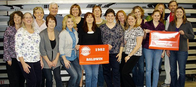 Baldwin High School's 1982 and 1996 girls' basketball teams were honored Saturday in Salina for their Class 4A state championships. Pictured, from left, from the 1982 team are manager Margaret (McCrary) Hadle, Karen (Wright) Johnson-Phillips, Sharon (Johnson) Soltero, Deena (Brecheisen) Green, Ellen (Calderwood) Clark and Julie (Gish) Lawrence and from the 1996 team are LeAnna (Hulce) Ullom and Stacy (Zuzzio) Hutchins. Back row from the 1982 team are Michelle (Craig) Kirk, Debbie (Randel) O'Donoghue, coach Ted Zuzzio, Pattie (Shay) Myres and Janet Mullins and from the  1996 team are Ann Martin, Trina (Bierman) Dibbini, Mary Denning and assistant coach Mike Curran.