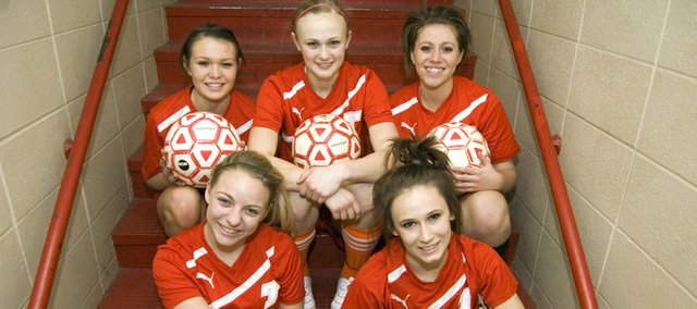 The Tonganoxie High soccer team's five seniors, (front) Carson Simmons, Alex Bartels, (back) Grae Wilbanks, Ashley Kotowske and Carlea Richert, want to see a vast improvement on last year's four-win total. Captains Simmons and Bartels think the Chieftains' new head coach, Justin Seever, and some talented underclassmen will help THS reach that goal.