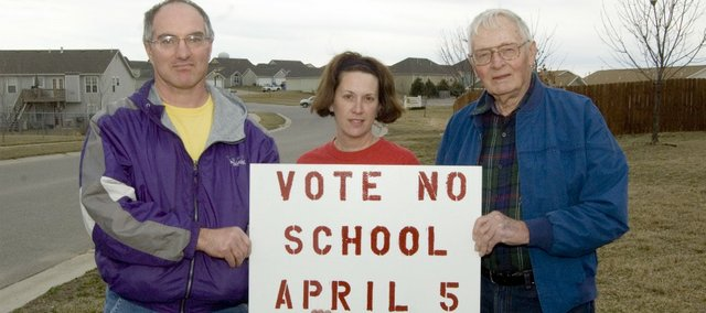 From left, Dale Woodyard, Gretchen Busche and Lester Meinert hold a sign expressing their opposition to USD 464s bond issue. Among the groups planned activities is an informational meeting 3 p.m. Saturday at Tonganoxie VFW Post 9271. USD 464 Superntendent Kyle Hayden has been invited to give the districts informational presentation on the $26.9 million bond proposal at the meeting.