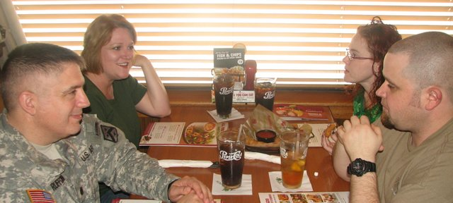 Rich and Doris Ruffcorn, left, and Amanda and Chris Dearinger chat at the Leavenworth Applebee's restaurant this past week. The couples met for the first time since Rich Ruffcorn stopped on the side of the road and helped Amanda Dearinger take her daughter to Basehor Elementary School during a multiple sclerosis episode in December.