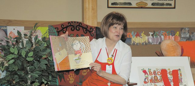 Jeanne Dunbar, children's coordinator for the Bonner Springs City Library, reads a book about vegetables for Tuesday's children's storytime. Information about healthy snacks and a similar story time will be part of the activities at the Books, Blocks & Bubbles Young Child Fair April 2 at the library.
