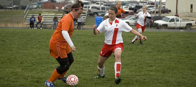 Tonganoxie High freshman defender Aly Bartholomew steps in front of a Bonner Springs attacker Monday in the Chieftains' 3-0 home loss to the Braves.