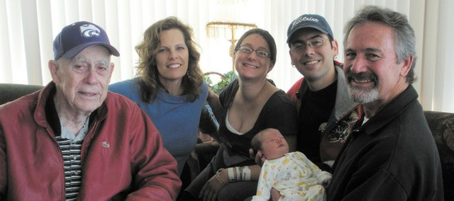 Pictured just after the recent birth of a fourth generation of the Hoins family at St. John Hospital are, from left:  Dr. John Hoins, Ann Hoins, Celeste Hoins, Eric Hoins, John Hoins and the most recent addition to the family, Jane Ann Hoins, born Feb. 11, 2011.