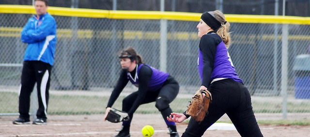 Baldwin High School junior Hayley Schwartz throws a pitch during the second inning of Tuesday's home doubleheader. Schwartz pitched a one-run game in the opener as Baldwin won 5-1. The Bulldogs swept the Eagles as they won the second game 7-5.