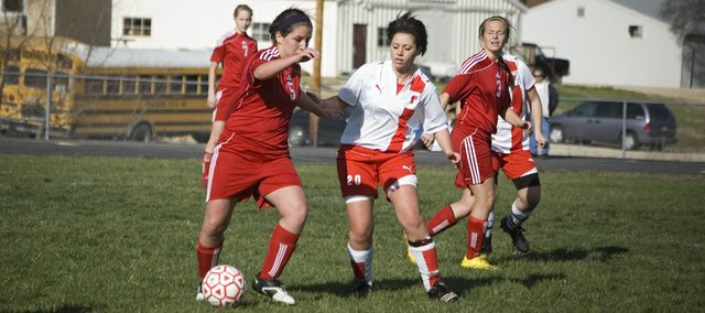 Tonganoxie High senior Carlea Richert looks to cut off a Lansing forward Friday afternoon in the second half of the Chieftains' 3-0 home loss to LHS.
