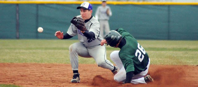 Baldwin High School sophomore Tyler Cawley waits to field a ball at second base while a De Soto runner steals the base. Baldwin lost both games at De Soto last week, losing 16-1 and 10-6.