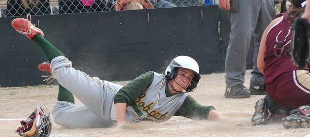 Basehor-Linwood&#39;s Courtney Leive slides safely into home for a game-tying run against Silver Lake.