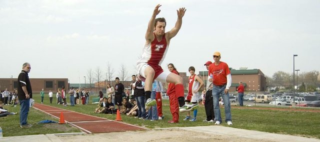 Tonganoxie High Dylan Scates extends his arms and legs on a long-jump attempt Friday at the Bobcat Relays in Basehor. Scates won both the long jump and triple jump events at Basehor-Linwood.