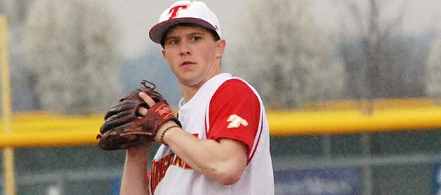 Tonganoxie High shortstop Ethan Lorance gathers before throwing to first base at Mill Valley on Thursday. The Chieftains were swept by the Jaguars in Shawnee. On Monday, however, THS picked up two victories at Turner, in Kansas City, Kan., with wins of 13-10 and 18-11.