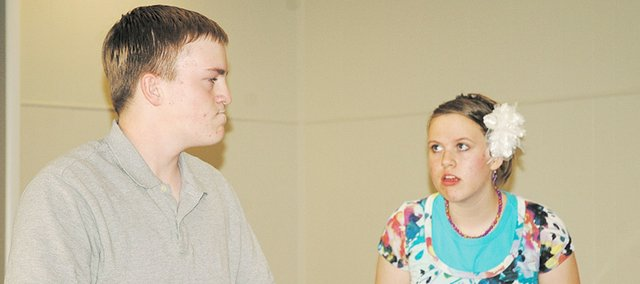 """Loran Wiley, left, plays """"Mr. Grump,"""" and Abigail Wiley his precocious young neighbor in the duet performance """"Front Porch Chronicles."""" The Wiley siblings are performing their duet this week at the American Association of Christian Schools' national competition in Greenville, S.C."""