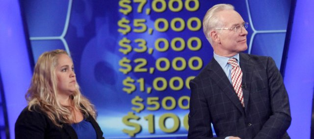 "Jaclyn Naster, a former Basehor-Linwood High School teacher, participates in a taping of the game show ""Who Wants to Be a Millionaire"" with guest host Tim Gunn of ""Project Runway"" fame."