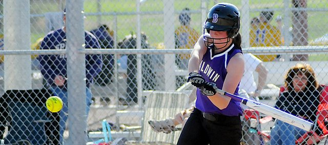Baldwin High School junior Madeline Brungardt swings for a pitch Tuesday afternoon. Brungardt scored the only run in the Bulldogs' 1-0 victory against Spring Hill.