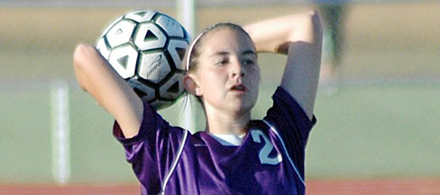 The USD 348 Board of Education approved a motion to start making a schedule for a Baldwin High School girls soccer program in the spring of 2012. Here sophomore Carrie Deitz throws a ball in-bounds during a game at Eudora this fall.