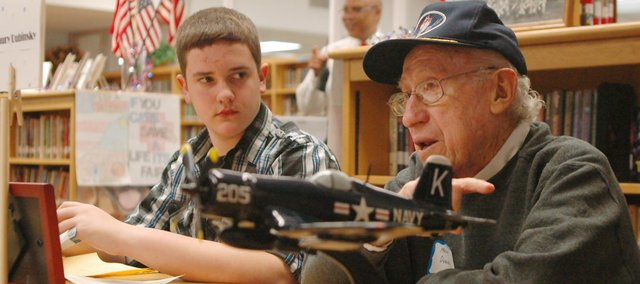 Trailridge eighth-grader Josh Patrick listens as Maury Dubinksy, a World War II veteran, recounts his naval service. Dubinsky was among a dozen veterans to visit the school last Tuesday for an interview project for Chaussee Druen's social studies classes.