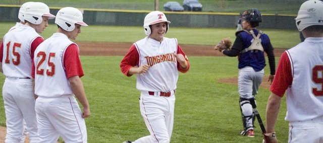 Jeremy Wagner trots home after hitting a two-run homer for Tonganoxie High Monday against Baldwin. The blast gave the Chieftains a three-run lead, but BHS came back and won the game, 11-8.