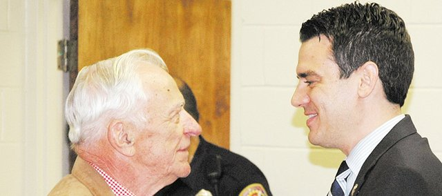 Congressman Kevin Yoder (right) greets former Bonner Springs mayor Ted Stolfus. The two were at Yoder's town hall meeting Monday at Bonner Springs City Hall.