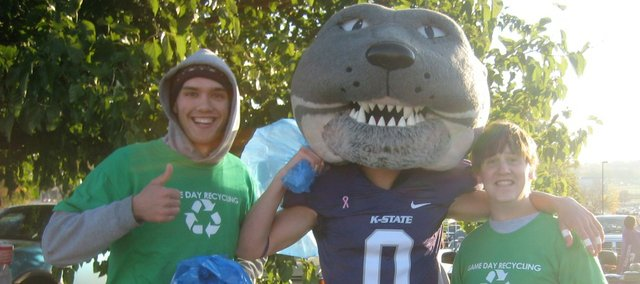 Zack Pistora, left, meets with K-State mascot Willie the Wildcat at a KSU football game. Pistora has been involved the last three years with Students for Environmental Action at K-State. The group started a recycling program at KSU home football games.