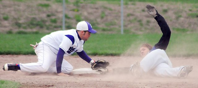 Baldwin High School senior Justin Vander Tuig slides head-first into second base, just narrowly beating the tag from the Louisburg short stop. Vander Tuig recorded a double on the play and helped spark a four-run rally in the sixth inning. BHS won the first game 9-4.