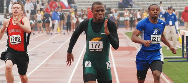 Basehor-Linwood senior Daniel Prioleau storms through the finish line during the 100-meter dash preliminaries on Friday, April 22, 2011, at the Kansas Relays. Prioleau had the seventh-best time and advanced to Saturday's finals.