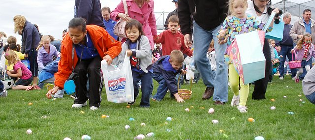 Children and their parents rush to pick up eggs Saturday, April 23, during GracePoint Church's second Easter Egg Drop event. The event drew throngs of parents and children to the ball fields next to the church, 5425 Martindale Road.