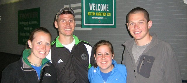 Levi Huseman, second from left, poses with friends in front of a Boston Marathon sign. Huseman, a 2005 Tonganoxie High graduate, ran in the world famous race on April 18 in Boston. Joining him for the trip were (from left) girlfriend Lindsey Wiegele, her friend Alyssa Auld and a Kansas University classmate of Huseman's, Diego Dilladron.