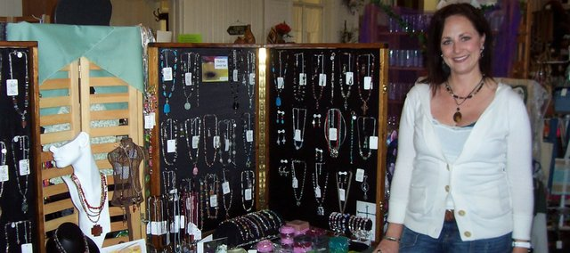 Emily Foster shows off some of the jewelry she crafts from natural stones and antiqued metals. Her work is available at H Avenue in Tonganoxie and Bauhaus in downtown Lawrence. She also will have a booth at the Kansas Sampler Festival May 7 and 8 in Leavenworth.
