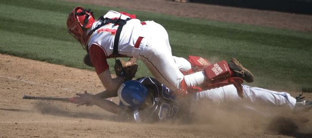 Tonganoxie High catcher Dylan Fosdick tags out Holton base runner Garrett Burns in the bottom of the fourth inning Thursday afternoon at CommunityAmerica Ballpark in Kansas City, Kan. The Wildcats came back from a six-run deficit to beat THS, 10-9, in the first round of the Butch Foster Memorial Baseball Classic.