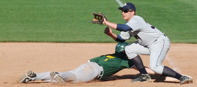 Basehor-Linwood's Jayce Rymer dives safely back to first base while St. James Academy's Brent Mitchell awaits the throw. BLHS beat St. James 7-5.