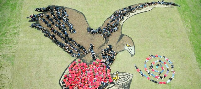 Students from Baldwin Elementary School Primary Center and Baldwin Elementary School Intermediate Center create a red-tailed hawk as part of Daniel Dancer's Art For the Sky last Wednesday.