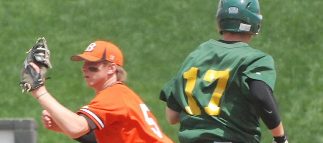 Bonner Springs first baseman A.J. Gidden makes a catch at first base as Basehor-Linwood's Tanner Garver is thrown out.