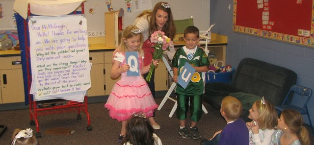 "Glenwood Ridge Elementary School kindergarten teacher Allison Budimlija announces ""Q"" and ""U"" (Chloe Siefkas and Tegory Gray) as a wedded pair Friday morning in her classroom. A reception followed, during which students enjoyed a British-style tea with iced tea and cupcakes. Six of 17 students said they liked the taste of tea after sampling it."