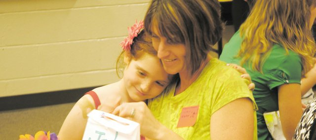 Jody Moritz shares a moment with her daughter Aspen at a Mother's Day Tea in 2010.