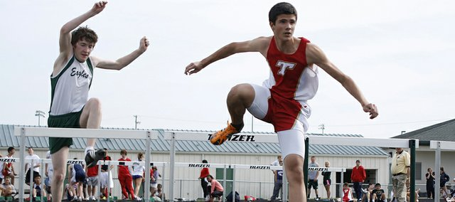 Tonganoxie High's Austin Searcy gazes ahead while clearing a jump in his heat of the 300-meter hurdles Friday at the De Soto Invitational. The THS boys finished fifth in the team standings at the meet.