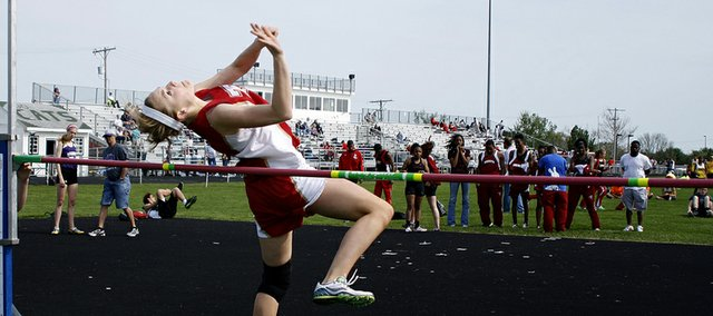 Tonganoxie High freshman Haley Griffin leaps off her left foot on a high-jump attempt Friday at the De Soto Invitational. A freshman, Griffin took first place in the event with a mark of 5 feet, 2 inches.