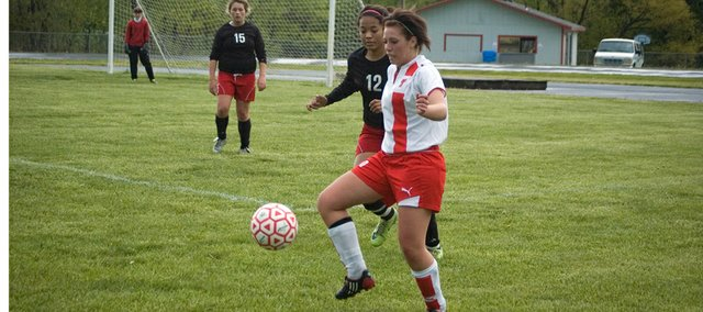 Tonganoxie High senior Carlea Richert goes after the ball in the first half against Ottawa on Thursday. The Chieftains lost their Senior Night match, 4-1.