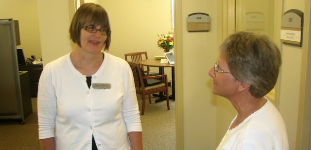 Diana Weaver (left), the new director of the Basehor Community Library, greets Lila White of the Friends of the Library group on Monday, her first day on the job. Weaver spent much of the day alongside outgoing director Carla Kaiser, touring the building and greeting patrons and community members.